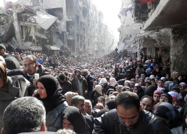People of Yarmouk waiting for food during the siege. Copyright: UNRWA