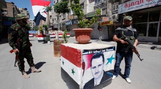 Security personnel loyal to Syria's President Bashar al-Assad stand guard at a checkpoint in Damascus May 27, 2013. Picture taken May 27, 2013.  REUTERS/ Alaa Al-Marjani (SYRIA - Tags: CIVIL UNREST POLITICS MILITARY CONFLICT) - RTX104TS